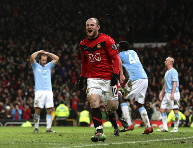 Wayne Rooney celebrates after his late header put Manchester United in front on aggregate in the 2010 semi final.