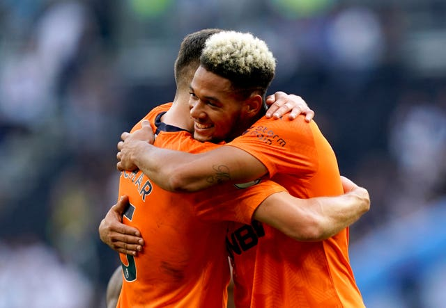 Newcastle's Joelinton celebrated with team-mate Fabian Schar after beating Tottenham