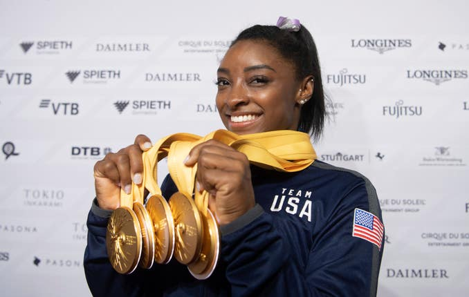 Simone Biles shows off the five gold medals she won at the World Gymnastics Championships in Stuttgart which saw her become the most decorated gymnast of all time