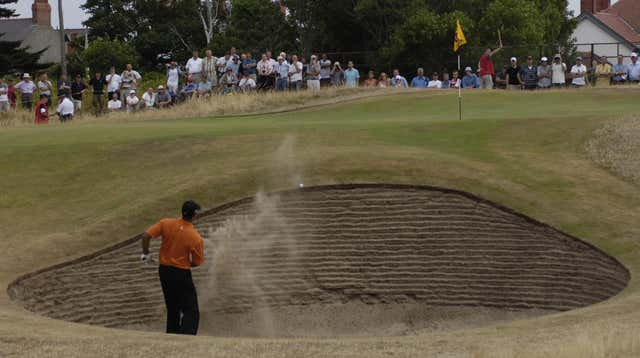 Woods plays out from a bunker at the 135th Open Championship at Royal Liverpool Golf Club, Hoylake