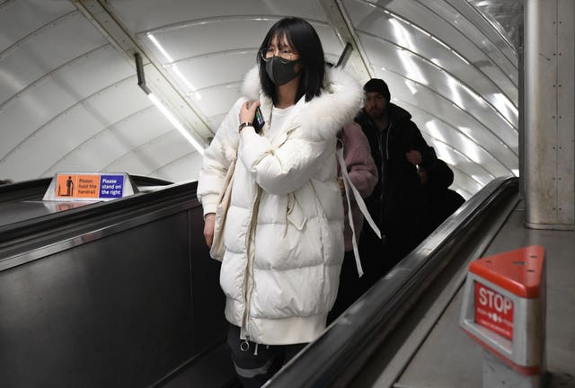 A women wearing a face mask at Leicester Square tube station (Kirsty O'Connor/PA)