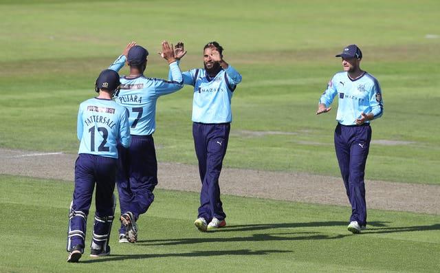 Rashid, centre, has taken 110 T20 wickets for Yorkshire (Martin Rickett/PA)