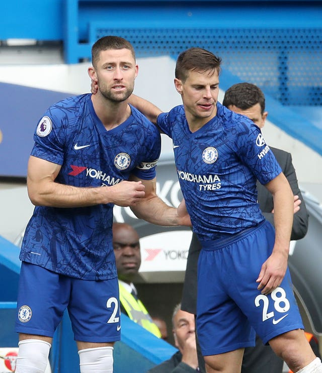 Gary Cahill, left, made just eight appearances for Chelsea last season