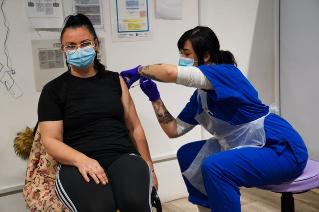A woman receives a jab at the vaccination centre