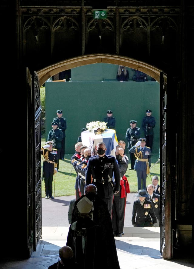 The Duke of Edinburgh's coffin is carried into his funeral service at St George's Chapel, Windsor Castle, Berkshire