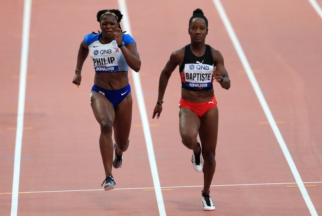 Asha Philip (left) was unable to make it through the 100m heats