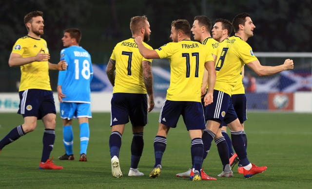 Kenny McLean (far right) got the Scots off to the perfect start, opening the scoring in a 2-0 win