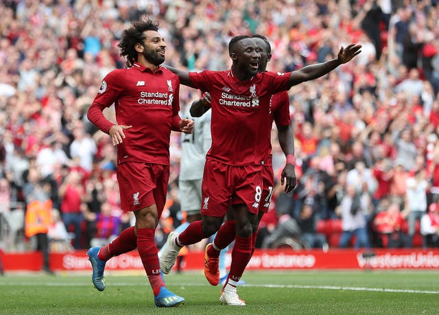 Keita (right) had a hand in Liverpool's opening goal for Mohamed Salah (left)