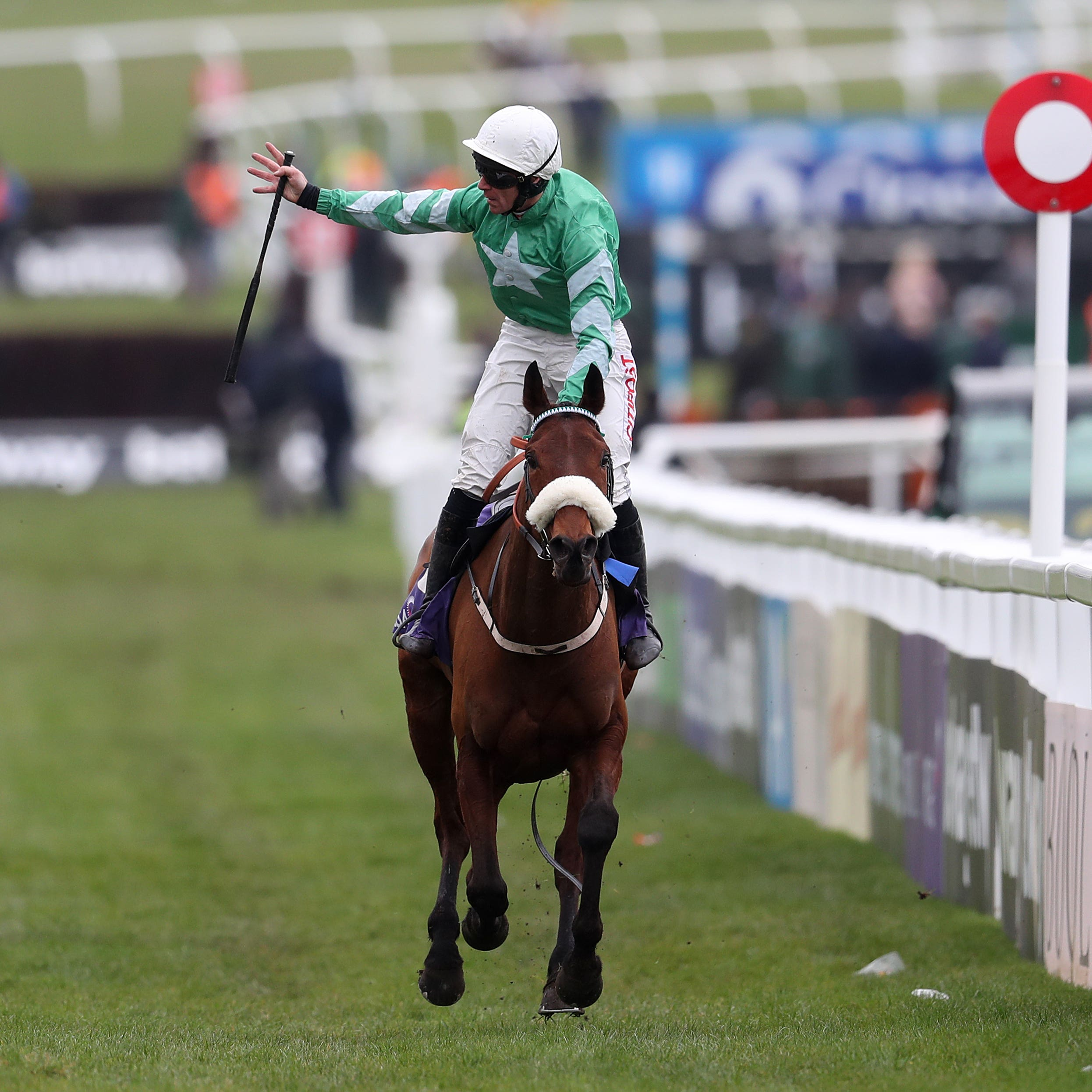 Davy Russell celebrates on Presenting Percy after winning the RSA Chase
