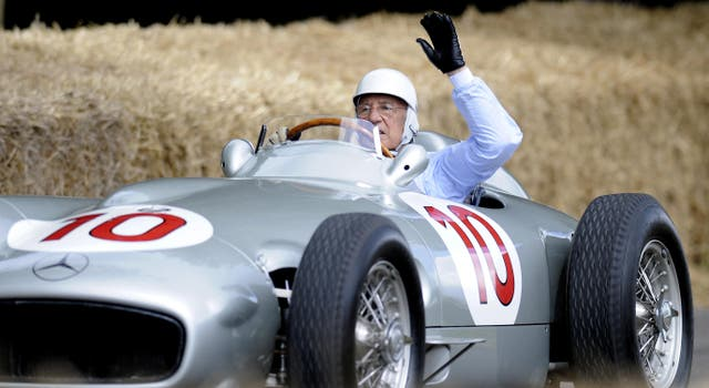 Stirling Moss driving an old Mercedes during the Goodwood Festival of Speed