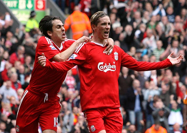 Torres celebrates scoring his second goal of an eventual Anfield hat-trick against Hull in September 2009