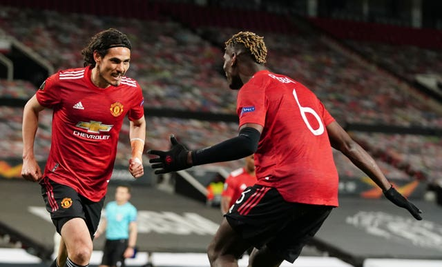 Edinson Cavani, left, celebrates his second goal with Paul Pogba