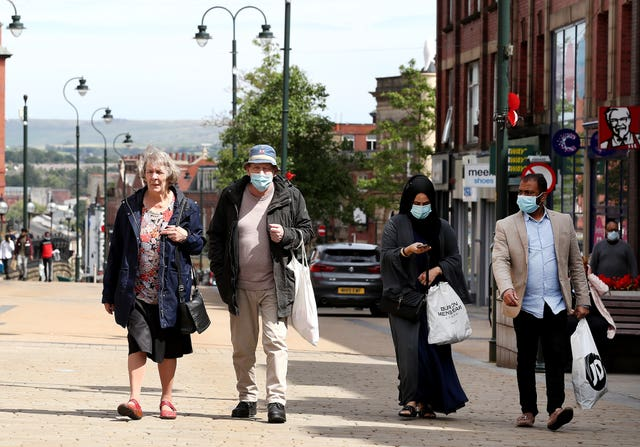 People shopping in Oldham (Martin Rickett/PA)