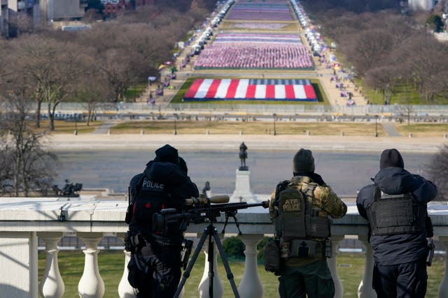 Law enforcement personnel monitoring surrounding areas during the 59th presidential inauguration at the US Capitol in Washington