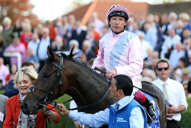 Frankie Dettori and Too Darn Hot after winning the Dewhurst Stakes