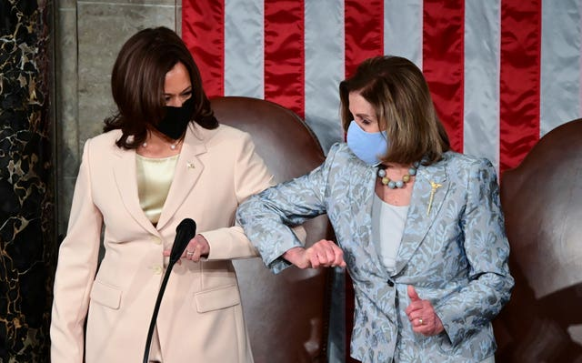 Vice President Kamala Harris, left, greets House Speaker Nancy Pelosi (Jim Watson/AP)