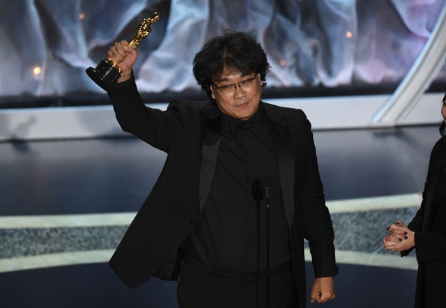 Bong Joon Ho accepts the award for best international feature film for Parasite at the Oscars