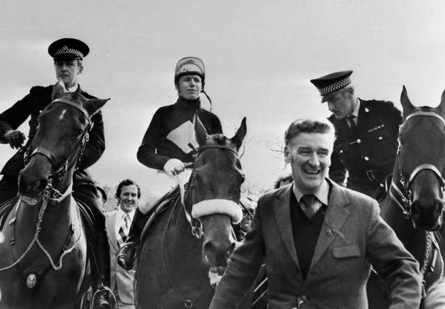 Red Rum being led in by Ginger McCain after winning his second successive Grand National in 1974