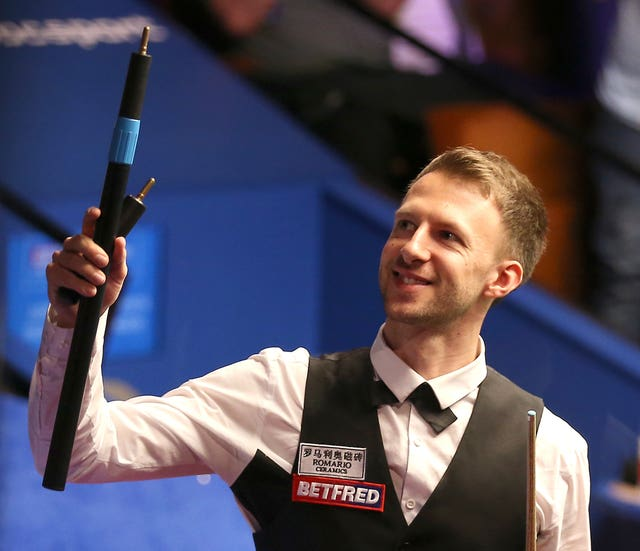 Judd Trump celebrates after his 10-9 victory