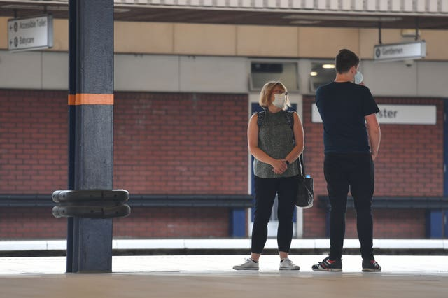 People wearing masks at Leicester railway station (Jacob King/PA)