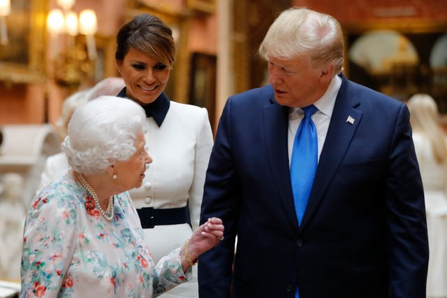 The Queen and US President Donald Trump view a special exhibition in the Picture Gallery of items from the Royal Collection of historical significance to the US