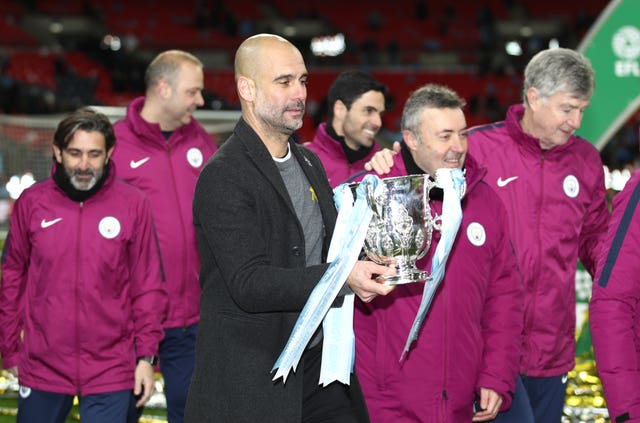 Pep Guardiola with the Carabao Cup trophy