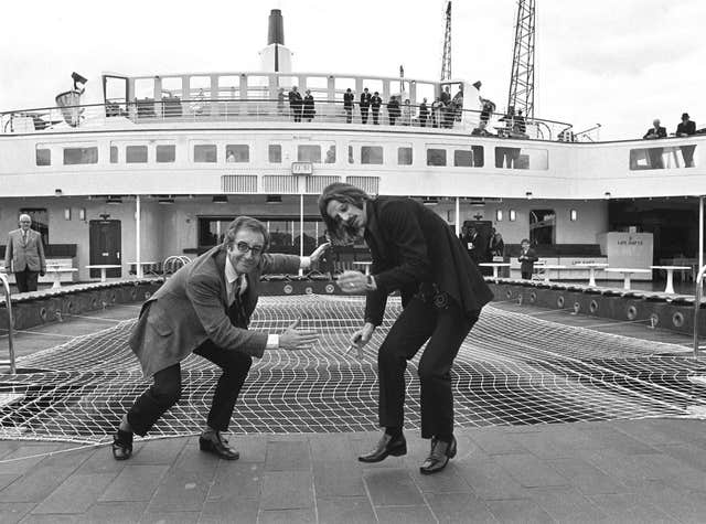 Peter Sellers and Ringo Starr getting ready for some deck games on board the QE2 at Southampton (PA)