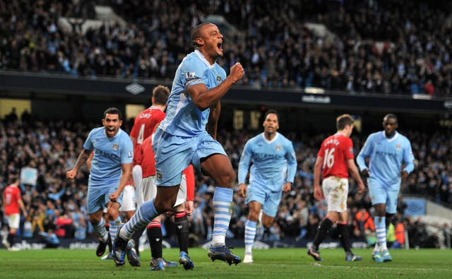 Vincent Kompany celebrates his decisive goal in the 2012 title race