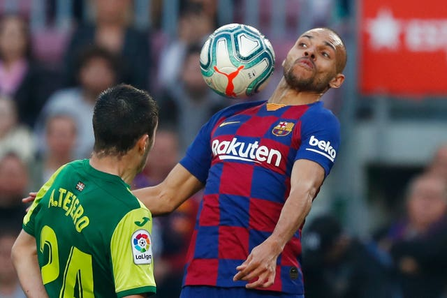 Barcelona's new signing Martin Braithwaite, right, controls the ball