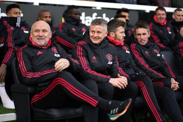 Mike Phelan (left) was previously assistant to Sir Alex Ferguson