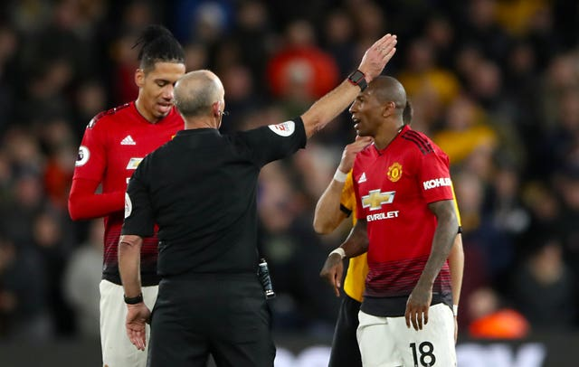 Mike Dean gives Manchester United's Ashley Young, right, his marching orders