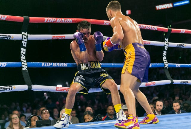 Vasiliy Lomachenko, right, defended his WBO and WBA lightweight titles against Britain's Anthony Crolla in Los Angeles