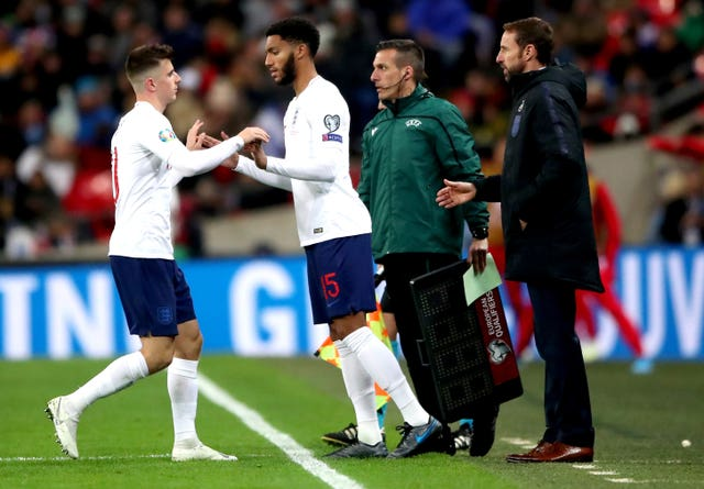 Joe Gomez, right, was jeered by some fans when he came on as a substitute against Montenegro