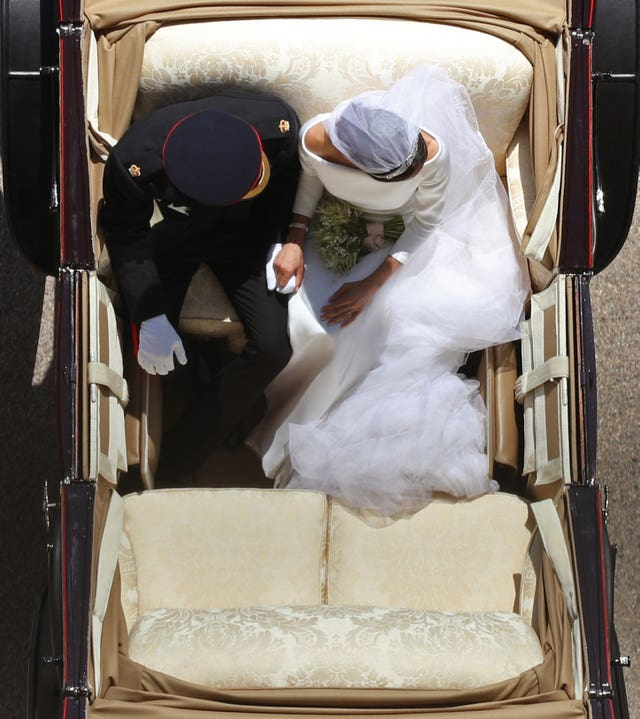 Prince Harry and Meghan Markle ride in an Ascot Landau along the Long Walk after their wedding in St George's Chapel