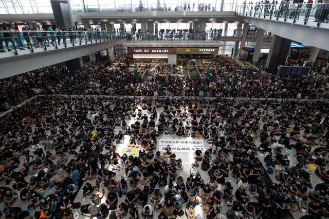 Protesters surround banners at Hong Kong airport
