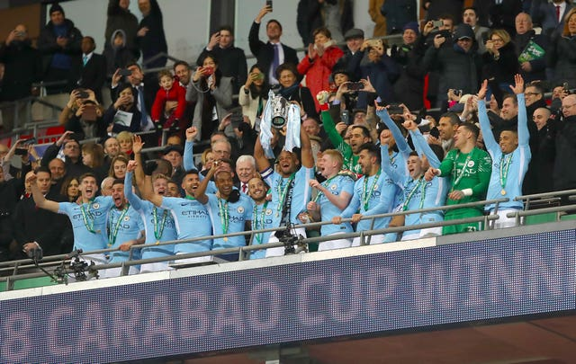 Manchester City's Vincent Kompany celebrates with the trophy alongside team-mates after the final whistle during the Carabao Cup Final