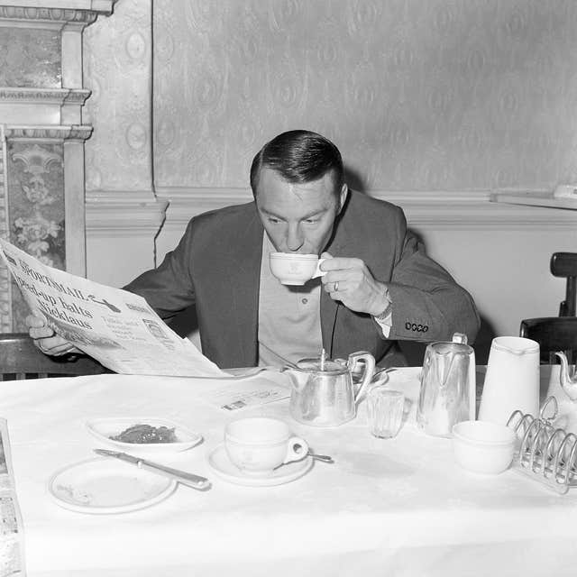 Jimmy Greaves reads a newspaper at the England team hotel during the 1966 World Cup