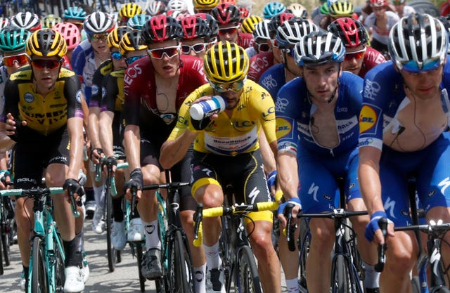 Julian Alaphilippe wears the overall leader's yellow jersey in the Tour de France