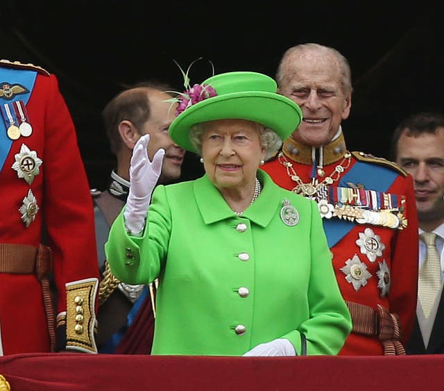 The Queen in green for the Trooping the Colour marking her official 90th birthday (Steve Parsons/PA)