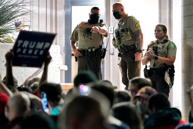 Officers at the door of the Maricopa County Recorder's Offi