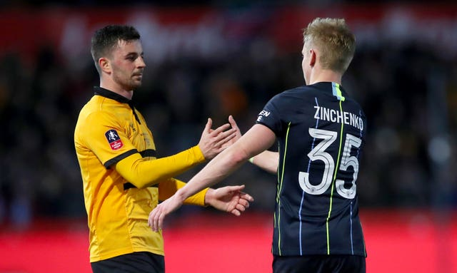Padraig Amond, left, is congratulated by Manchester City's Oleksandr Zinchenko