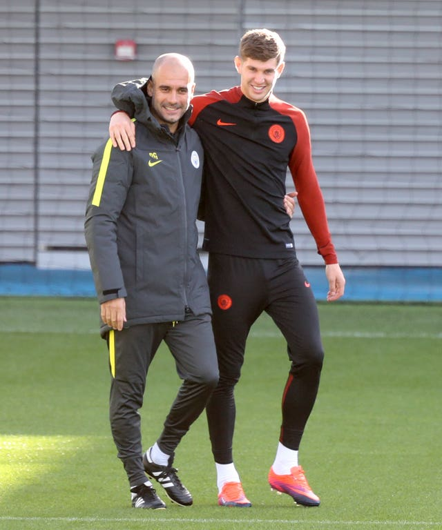 Guardiola (left) continues to rate Stones (right) very highly