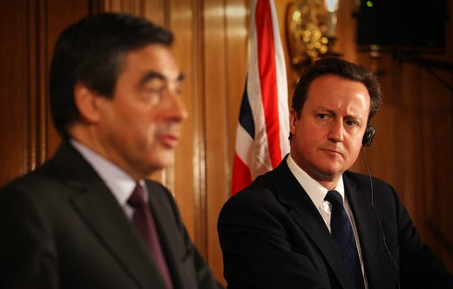 Francois Fillon with David Cameron at a Downing Street briefing (Peter Macdiarmid/PA)