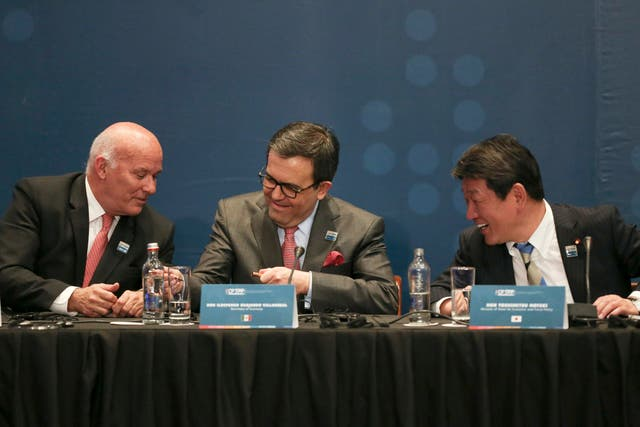 Peru's Trade Minister Eduardo Ferreyros, left, Secretary of Economy of Mexico Idelfonso Guajardo, centre, and Japan's Trans-Pacific Partnership minister Toshimitsu Motegi at the signing ceremony of the Comprehensive and Progressive Agreement for the Trans-Pacific Partnership (AP)