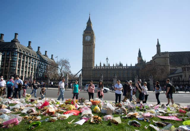 Floral tributes in Parliament Square outside the Palace of Westminster following the terror attack