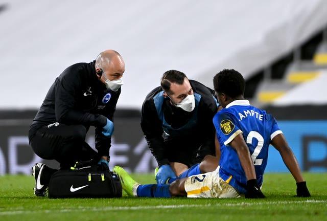 Brighton defender Tariq Lamptey receives medical treatment