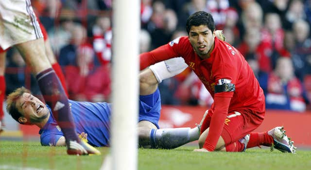 Suarez (right) and Chelsea's Branislav Ivanovic (left) on the ground after Suarez bit Ivanovic on the arm