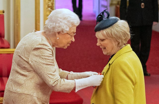 The Queen wearing gloves at an investiture