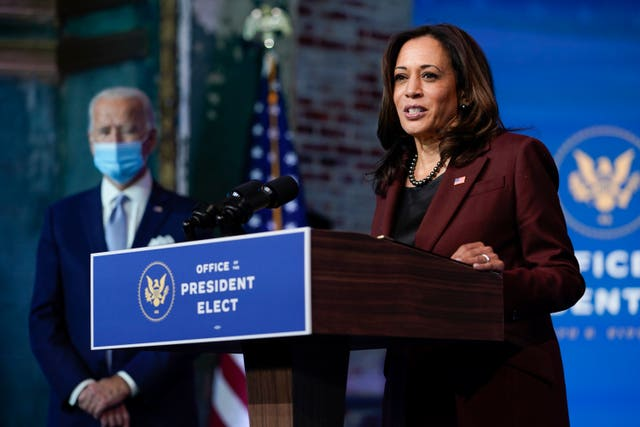 President-elect Joe Biden listens as Vice President-elect Kamala Harris speaks (Carolyn Kaster/AP)