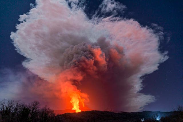 A fiery river of glowing lava flows from Mount Etna
